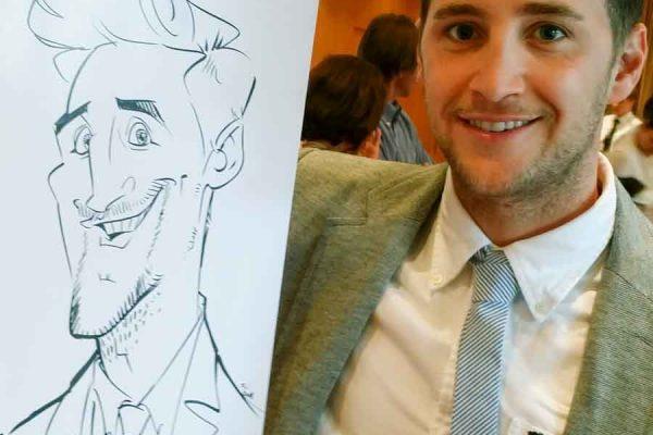 Schnellzeichner auf Messe, Karikatur auf Papier